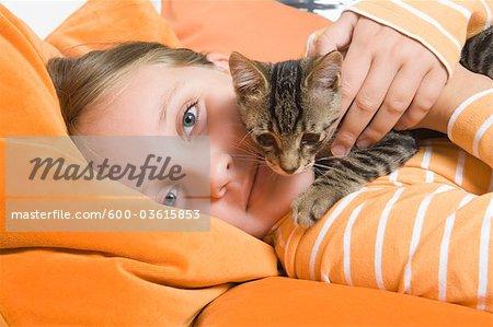 Little Girl Holding Kitten, Dusseldorf, North Rhine-Westphalia, Germany