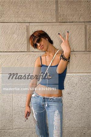 Portrait of Woman Making Hand Gesture