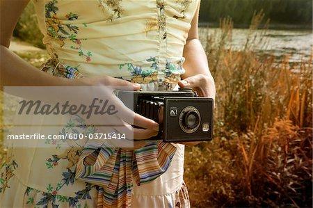 Woman Holding Folding Camera, High Park, Toronto, Ontario, Canada