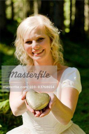 Woman Holding Golden Heart, Altenmarkt im Pongau, Salzburg, Austria