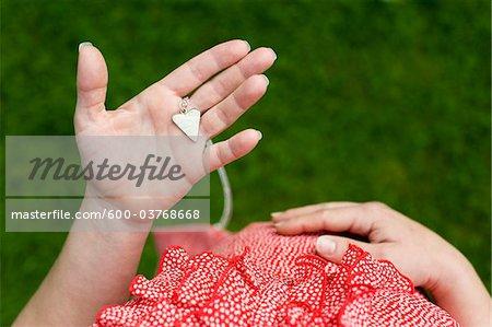 Pregnant Woman holding Heart Pendant, Salzburg, Austria