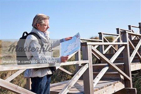 Man Reading Map, Cala Ratjada, Mallorca, Balearic Islands, Spain