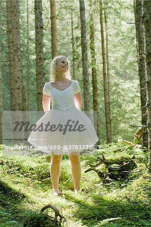 Woman Standing in Forest, Altenmarkt im Pongau, Salzburg, Austria
