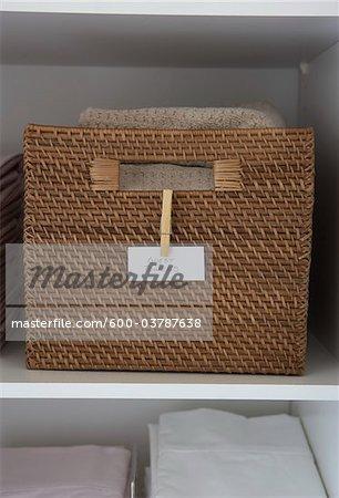 Basket of Towels in Linen Closet
