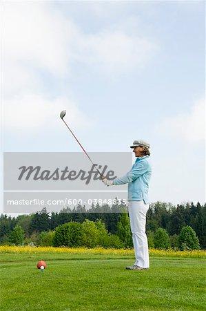 Woman Golfing, Berchtesgaden, Berchtesgadener Land, Oberbayern, Bavaria, Germany
