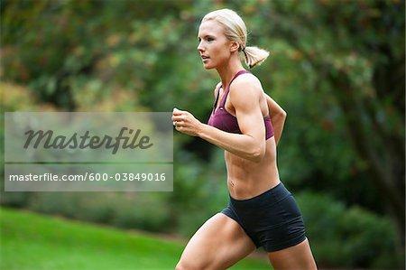Woman Jogging through Park, Seattle, Washington, USA