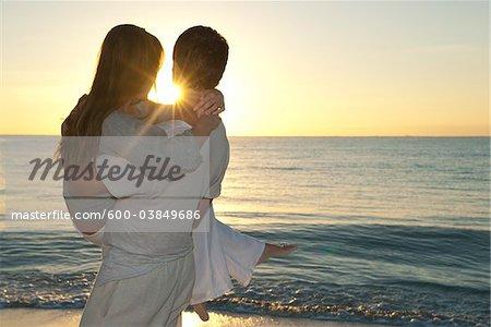 Couple at Beach at Sunset, Reef Playacar Resort and Spa, Playa del Carmen, Mexico