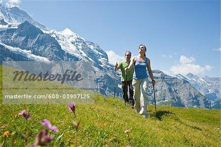 Couple Hiking using Walking Sticks, Bernese Oberland, Switzerland