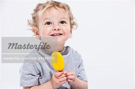 Portrait of Boy Holding Ice Cream Treat