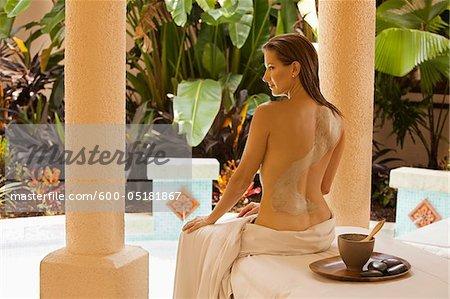 Woman getting Mud Treatment at Spa