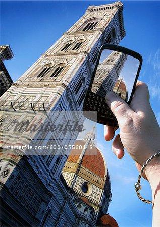 Woman's Hand Taking Photo of Basilica di Santa Maria del Fiore, Florence, Italy