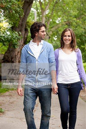 Young Couple Walking through Park