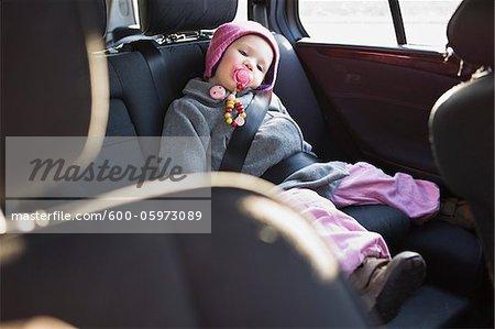 Portrait of Little Girl in Back Seat of Car