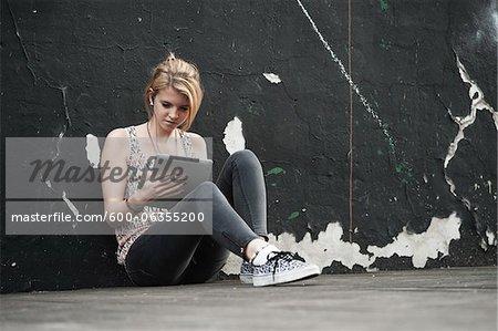 Teenage Girl Listening to iPad, Mannheim, Baden-Wurttemberg, Germany