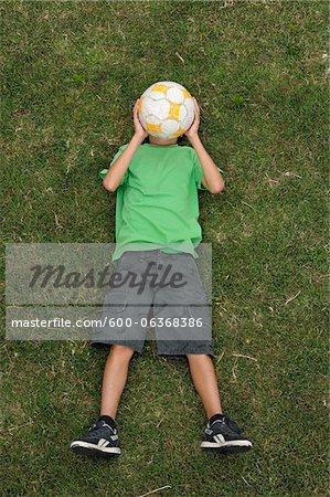 Boy Lying on Grass, Ile de Re, Poitou-Charentes, France