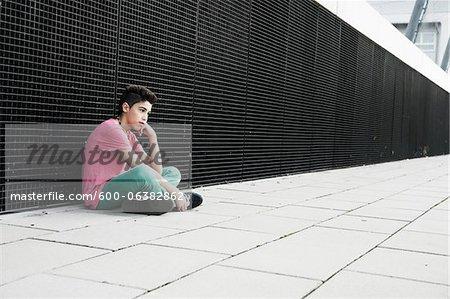 Boy Sitting on the Ground, Mannheim, Baden-Wurttemberg, Germany