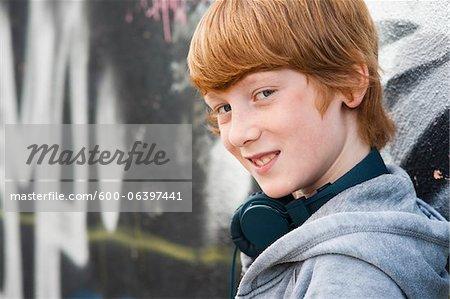 Close-up Portrait of Boy wearing Headphones, Mannheim, Baden-Wurttemberg, Germany