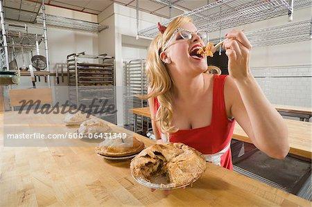 Woman Wearing Devil Horns at a Bakery, Oakland, Alameda County, California, USA