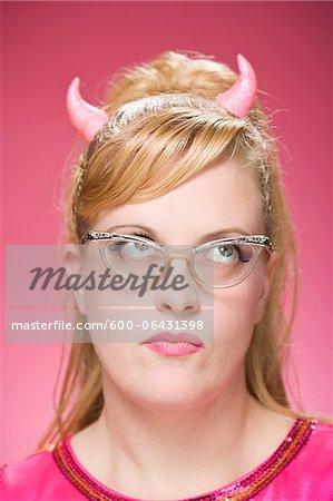 Portrait of Woman Wearing Devil Horns and Vintage Eyeglasses