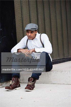 Portrait of Man Sitting on Step, Mannheim, Baden-Wurttemberg, Germany