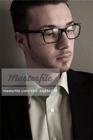 Head and Shoulder Portrait of Young Man wearing Glasses, Studio Shot