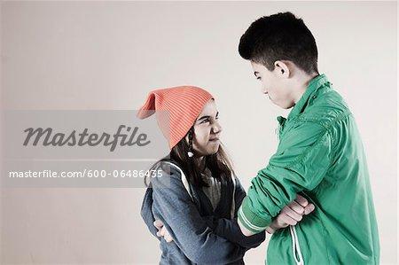 Girl and Boy Arguing in Studio