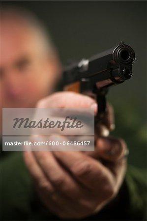 Close-up of Gun in Man's Hands, Mannheim, Baden-Wurttemberg, Germany