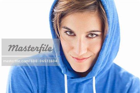 Head and Shoulders Portrait of Woman wearing Hoodie in Studio