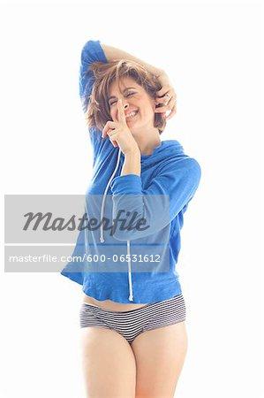 Portrait of Woman wearing Hoodie and Underwear in Studio