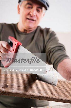 Man Cutting Lumber, Woodworking Project, in Studio