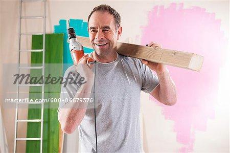 Mature Man Renovating his Home