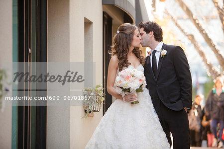 Portrait of Bride and Groom Kissing, Toronto, Ontario, Canada