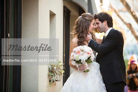 Portrait of Bride and Groom Nose to Nose, Toronto, Ontario, Canada