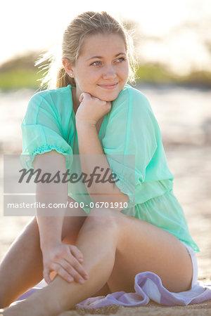 Portrait of Young Woman Sitting on Beach, Palm Beach Gardens, Palm Beach County, Florida, USA