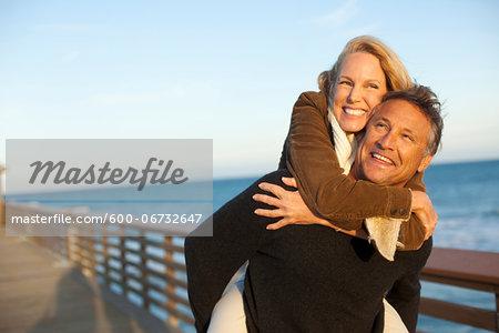 Mature Couple having Fun Walking along Pier, Jupiter, Palm Beach County, Florida, USA