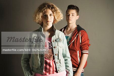 Portrait of Teenage Girl and Boy, Studio Shot