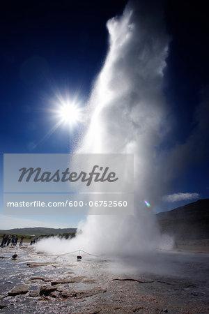 People watching Strokkur Geyser Erupting, Haukadalur, Iceland
