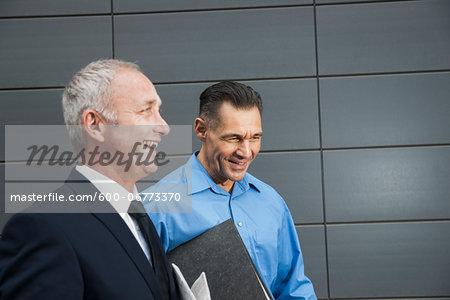 Businessmen Walking and Talking Outdoors, Mannheim, Baden-Wurttemberg, Germany