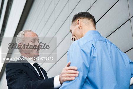 Businessmen Talking Outdoors, Mannheim, Baden-Wurttemberg, Germany