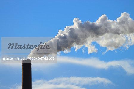 Smoking Smoke stack of Papermill, Stockstadt, Bavaria, Germany, Europe