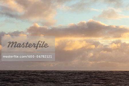 Ocean view in the Atlantic Ocean of clouds at sunset