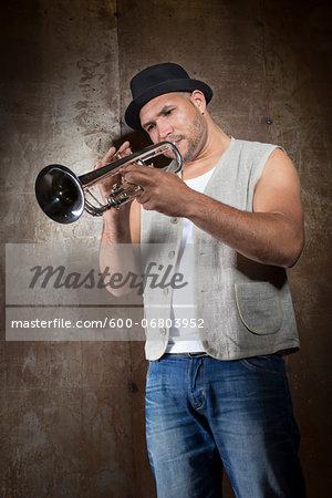 Portrait of Musician Playing Trumpet, Studio Shot