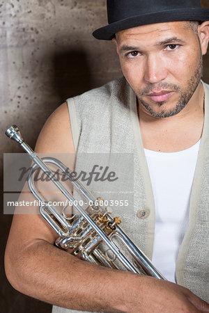 Portrait of Musician holding Trumpet, Studio Shot