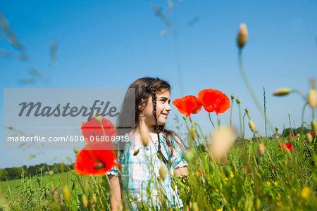 Portrait of Girl Standing in Flower Field, Mannheim, Baden-Wurttemberg, Germany