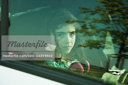 Girl in Minivan through Window, Mannheim, Baden- Wurttemberg, Germany