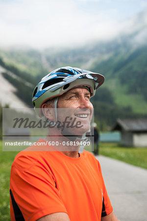 Portrait of Mature Man wearing Bike Helmet, Vilsalpsee, Tannheim Valley, Tyrol, Austria