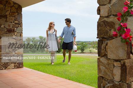 Couple Walking back to Hotel during Vacation, Sardinia, Italy