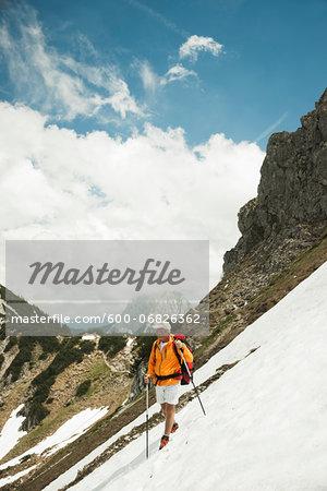 Mature man hiking in mountains, Tannheim Valley, Austria