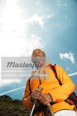 Portrait of mature man hiking in mountains, Tannheim Valley, Austria