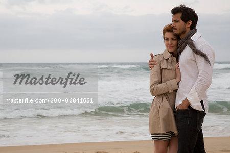 Young couple walking at the beach during a late summer afternoon holidays, Cala Cipolla, Chia Bay, Sardinia, Italy